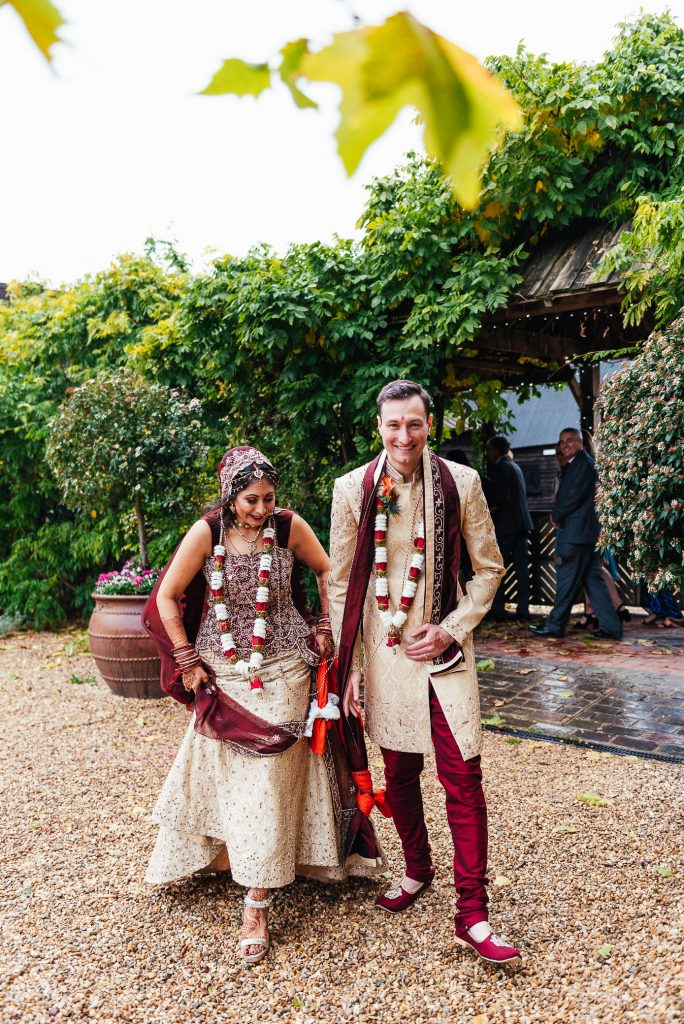 Newly married couple walk out of their ceremony together, South Farm Wedding
