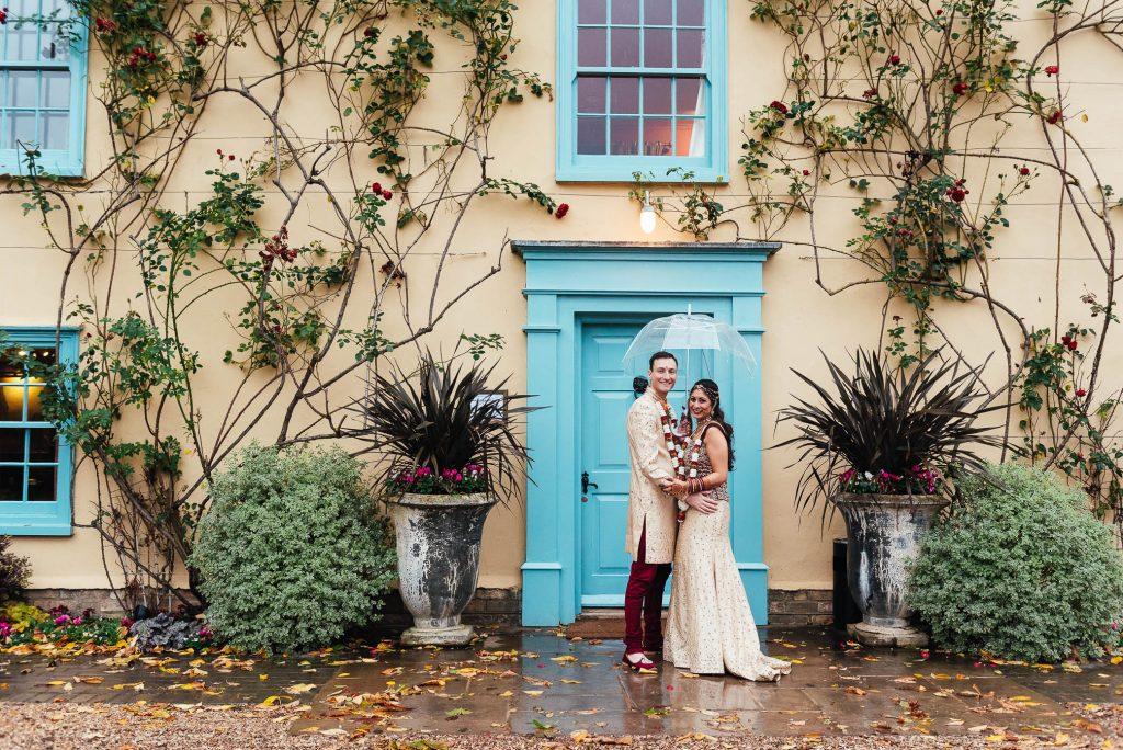 Couple stand outside South Farm wedding venue