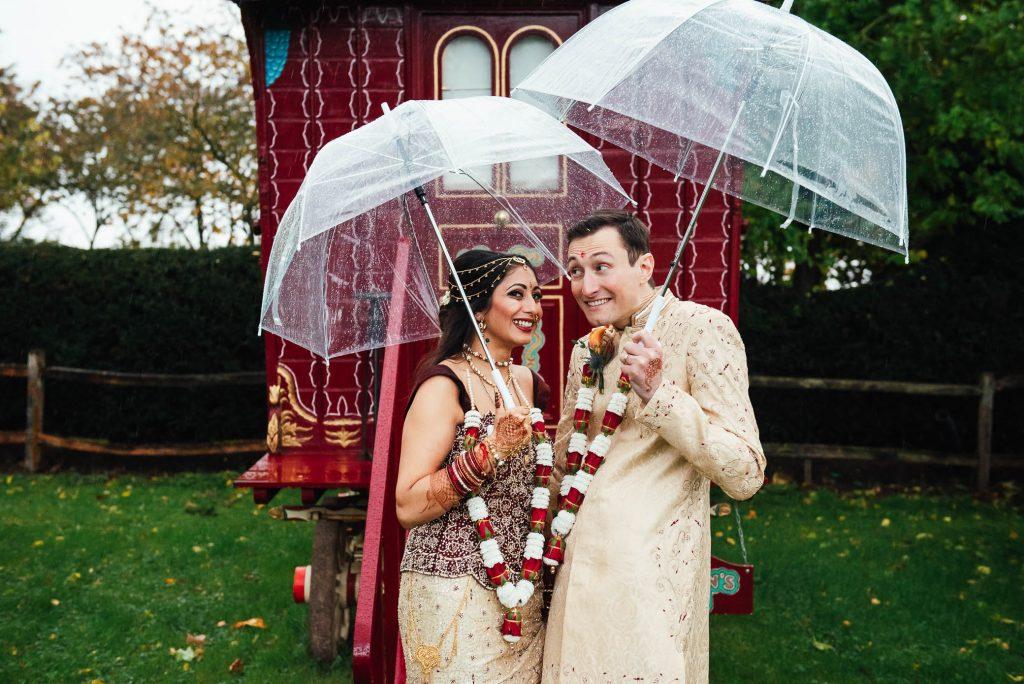 Fun wedding day portraits with vintage caravan background