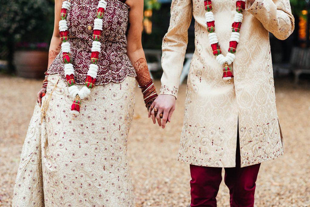 Couple walk together holding hands
