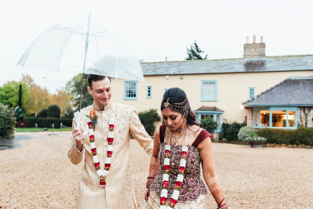 Couple walk together during couples portraits during their South Farm wedding