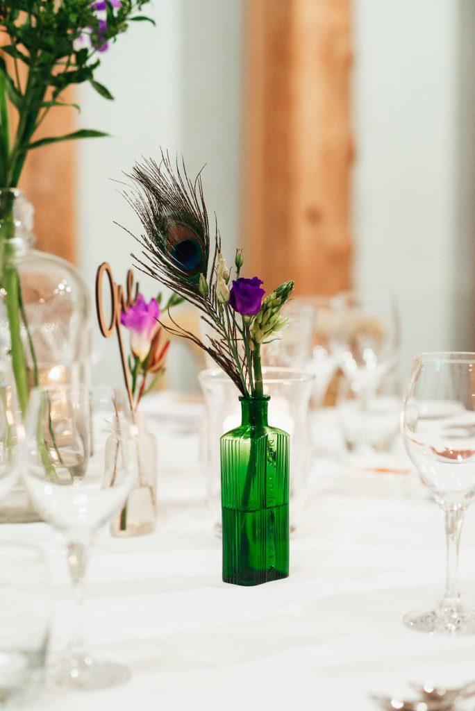 Vintage green wedding vase with peacock wedding decoration