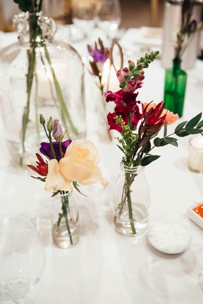 Delicate vintage wedding vases with autumnal wedding floral arrangements
