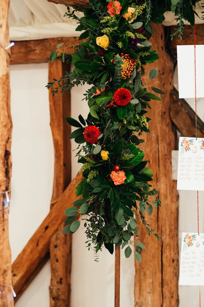 Wedding table setting flower arch