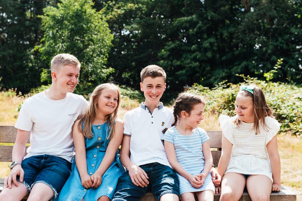 Natural family portrait at woodland family shoot