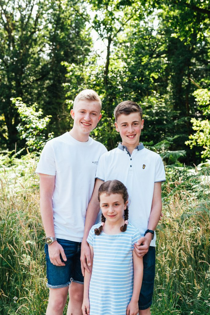 Candid family portrait at Chantry Woodland
