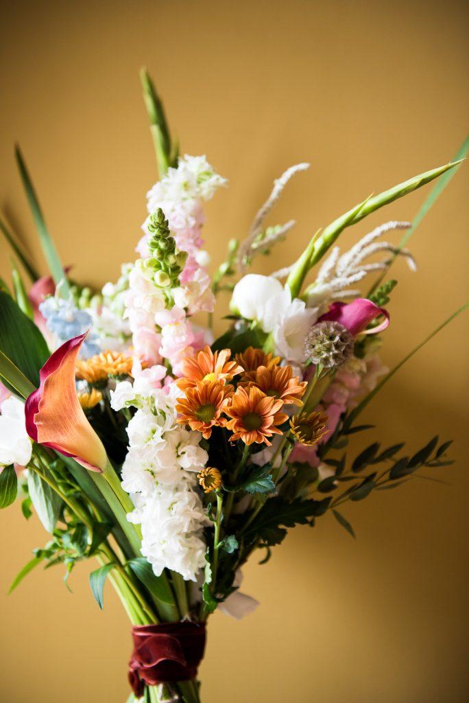 Creative Wedding flower bouquet on mustard orange background