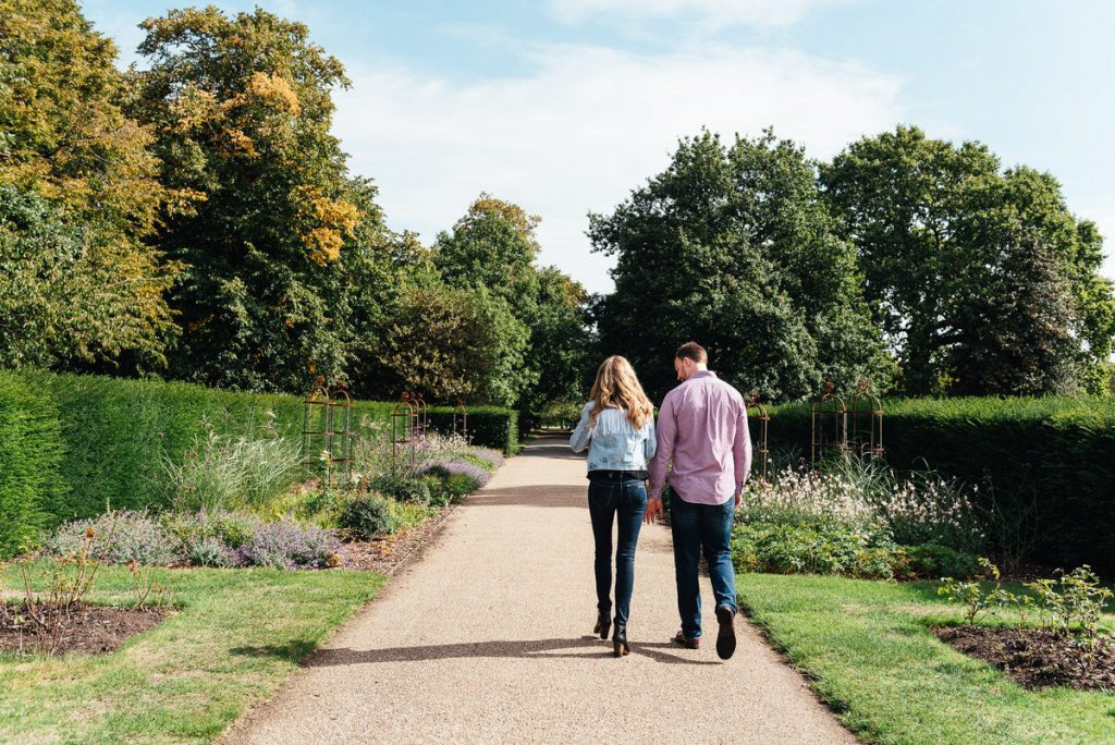 Natural and candid couple walking together in Greenwich Park Gardens