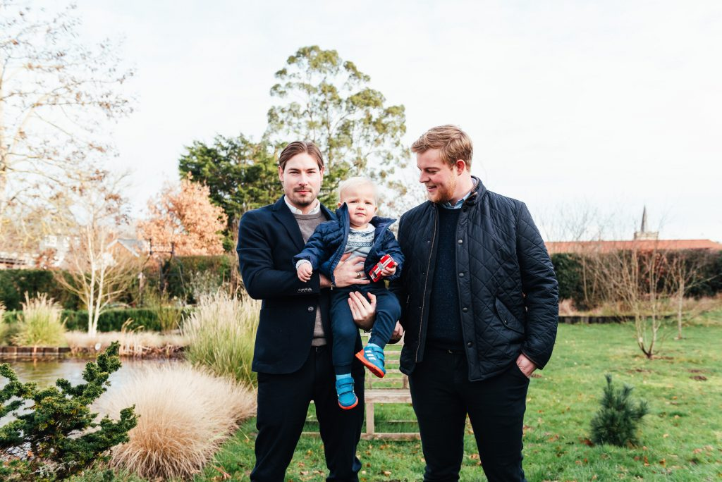 Uncles and Nephew Candid Outdoor Family Portrait