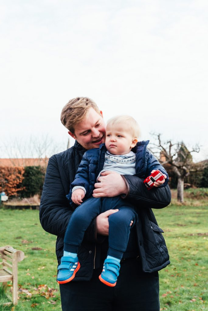 Relaxed portrait of uncle and nephew, Surrey Family Photography