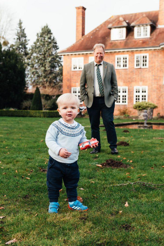 Scandinavian grandparents and grandson play in the garden