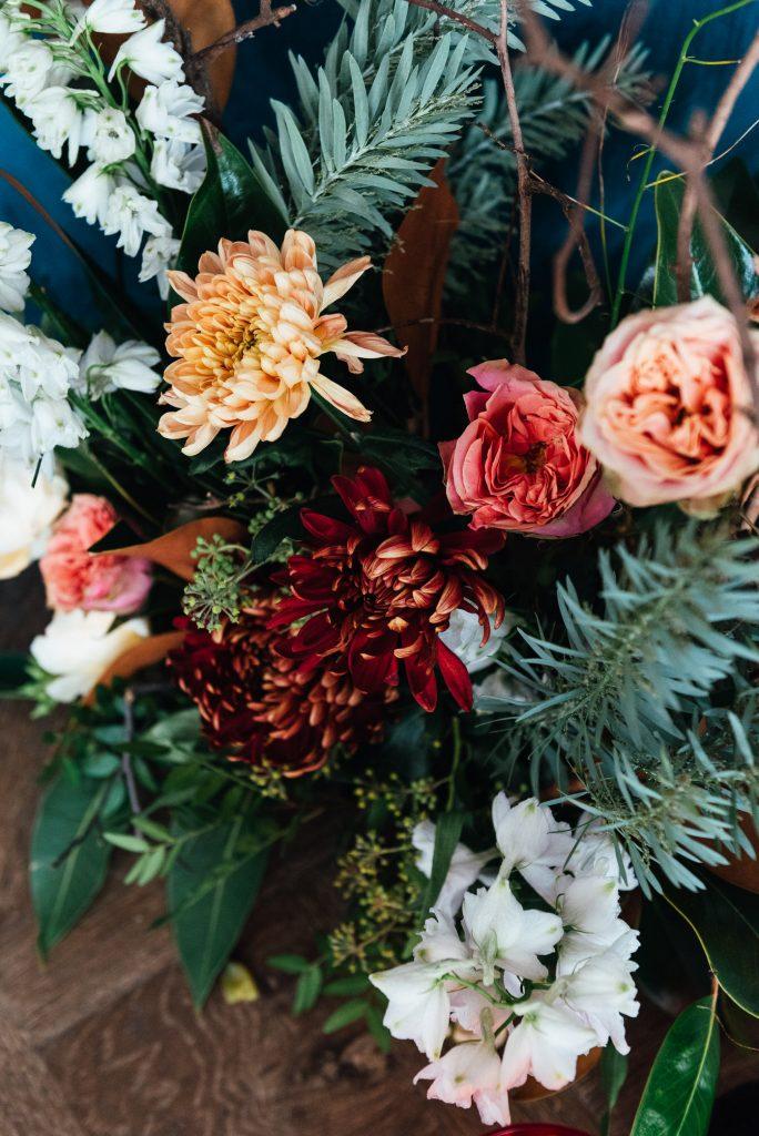 Dark and moody wedding florals, lgbtq friendly wedding photographer