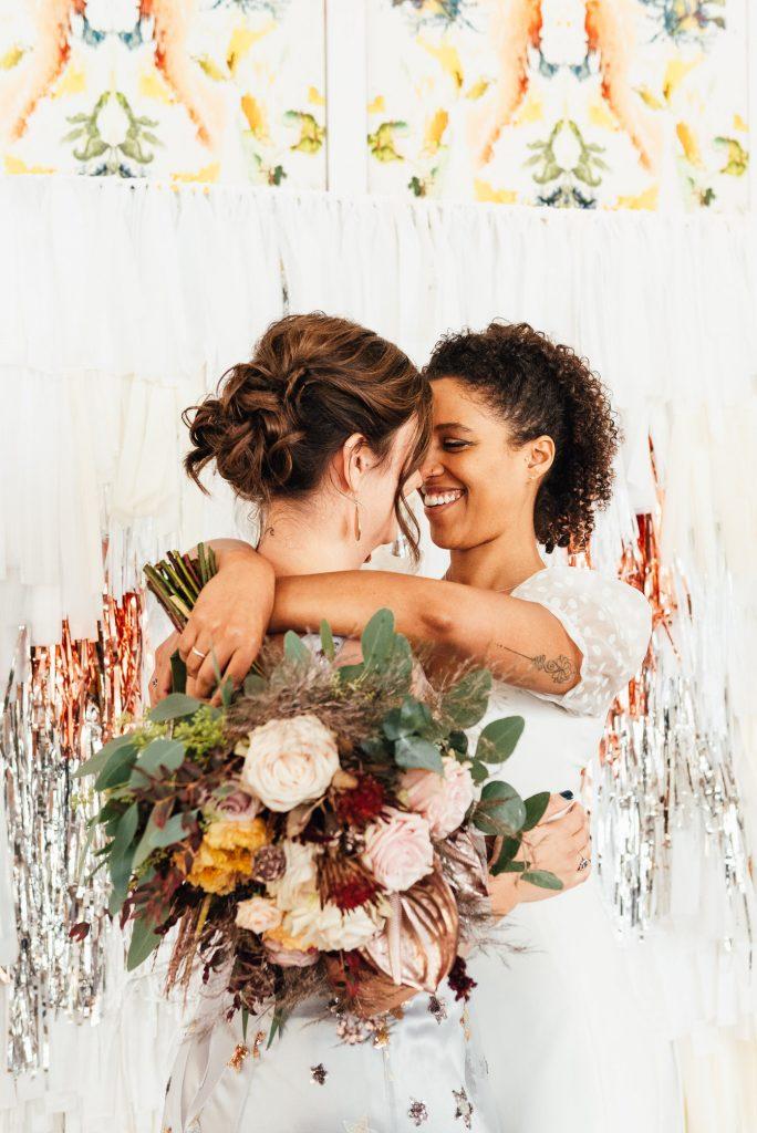 Loving bridal portrait with modern glitter backdrop
