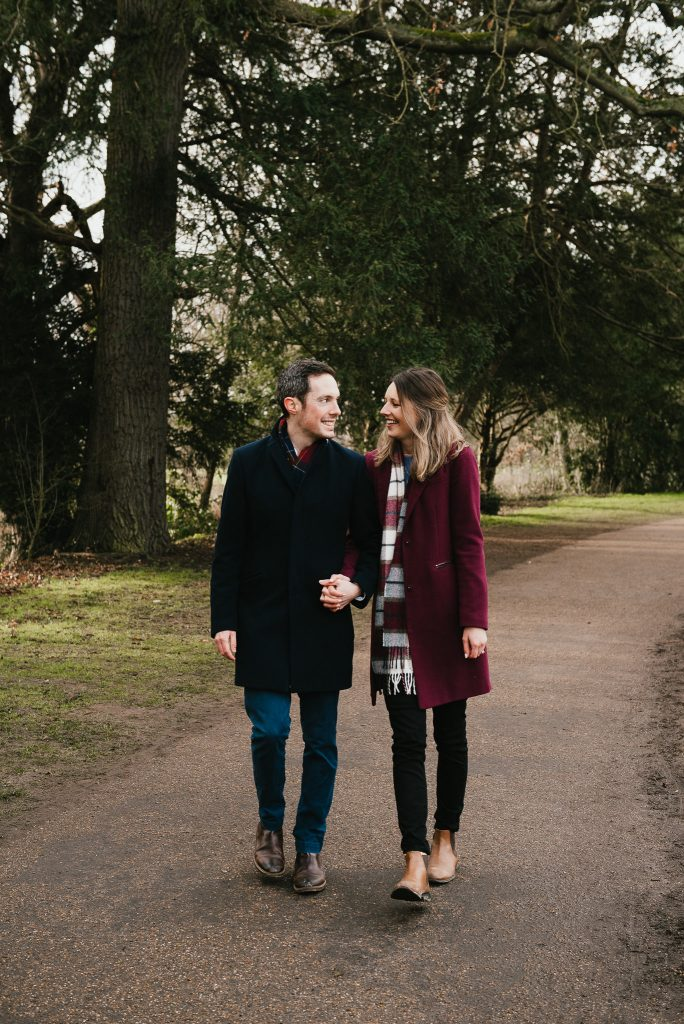 Couple walk together in Painshill Park