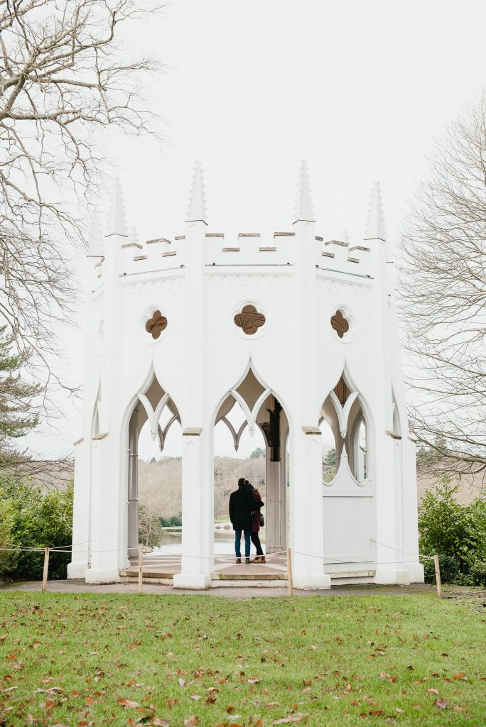 Couple Stand together in The Gothic Tower at Painshill Park