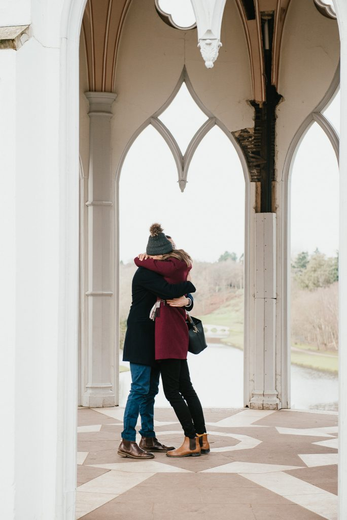 Couple embrace after just getting engaged