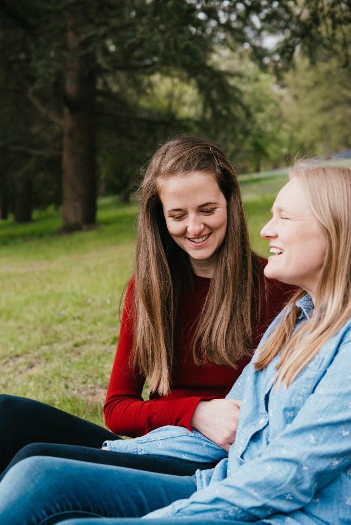 Couple Sit Together on Picnic Rug Smiling