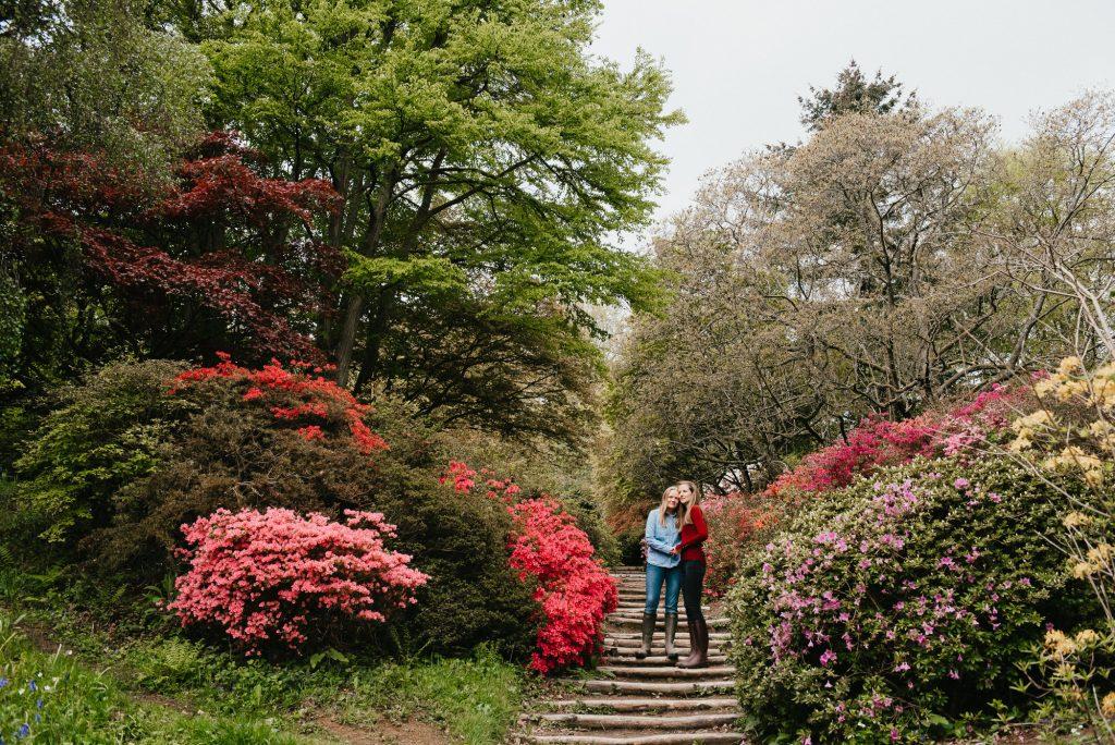 Couple Stand Together in Flower Garden Surrey