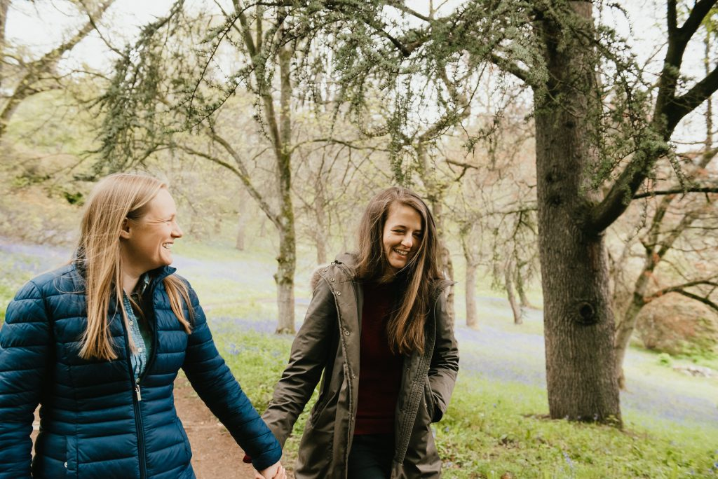 Natural and Candid Couple Walking Together in Winkworth Arboretum