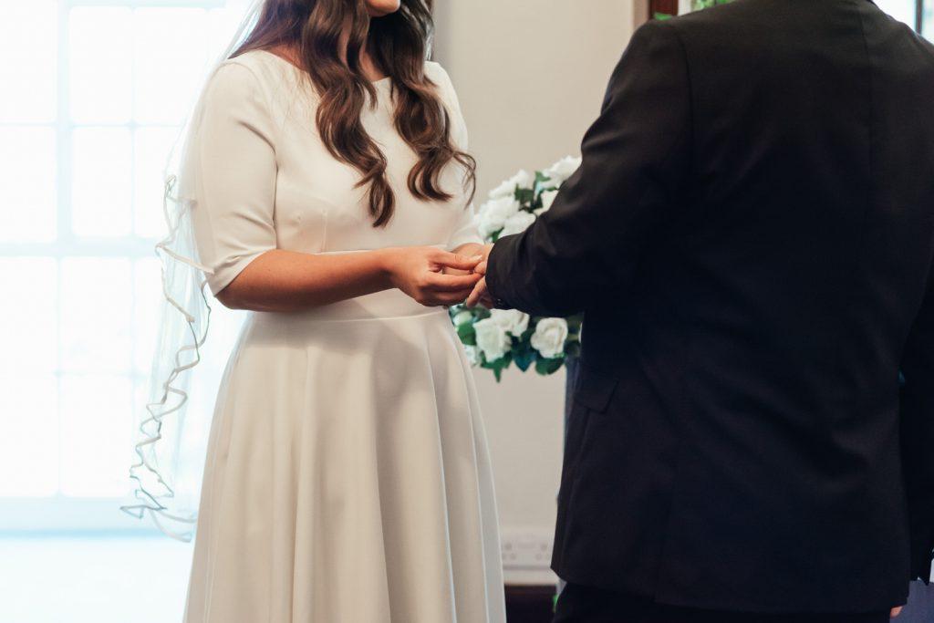 Couple Exchange Rings During Ceremony, Micro Surrey Wedding