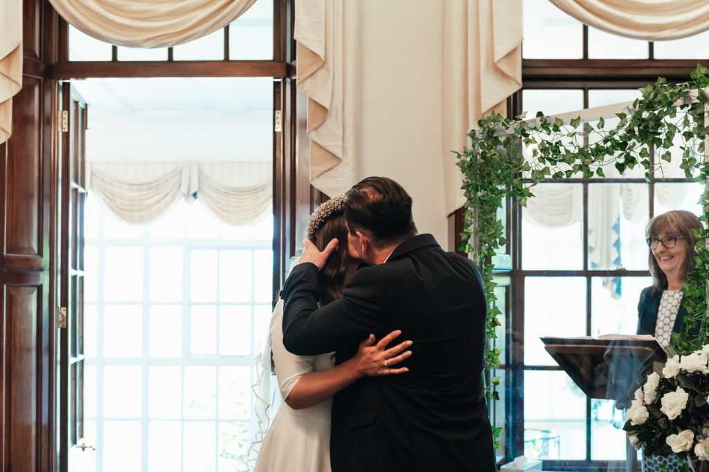 Couple Share First Kiss as Married Couple