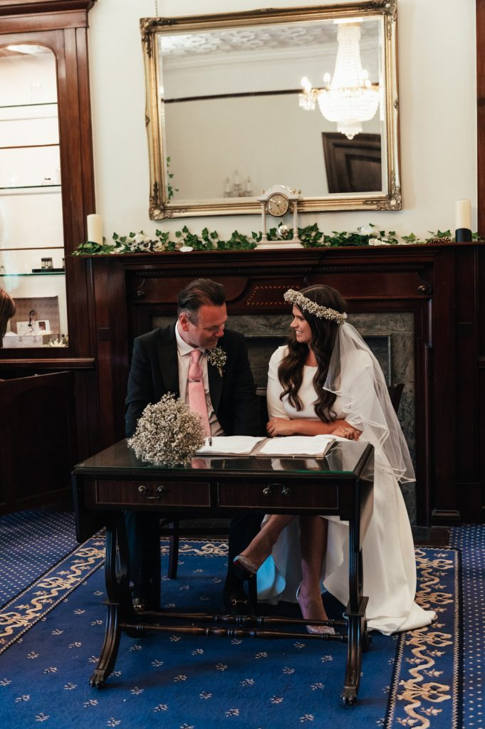 Couple Sign The Register Together