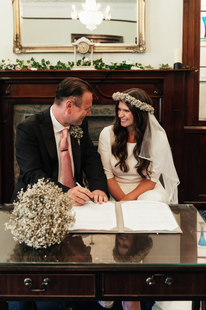 Couple Sign The Register Together, Leatherhead Registry Wedding
