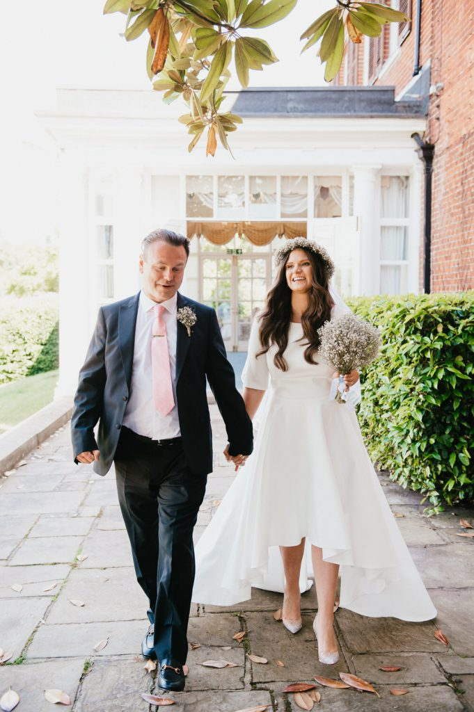 Couple Exit Leatherhead Registry Wedding Together