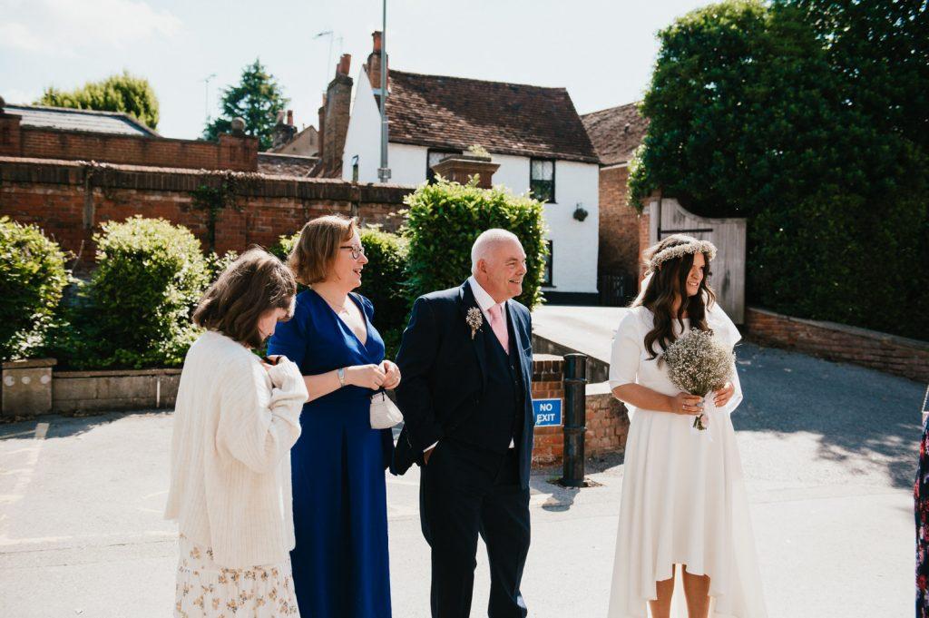 Guest mingle before wedding ceremony, Surrey wedding photography